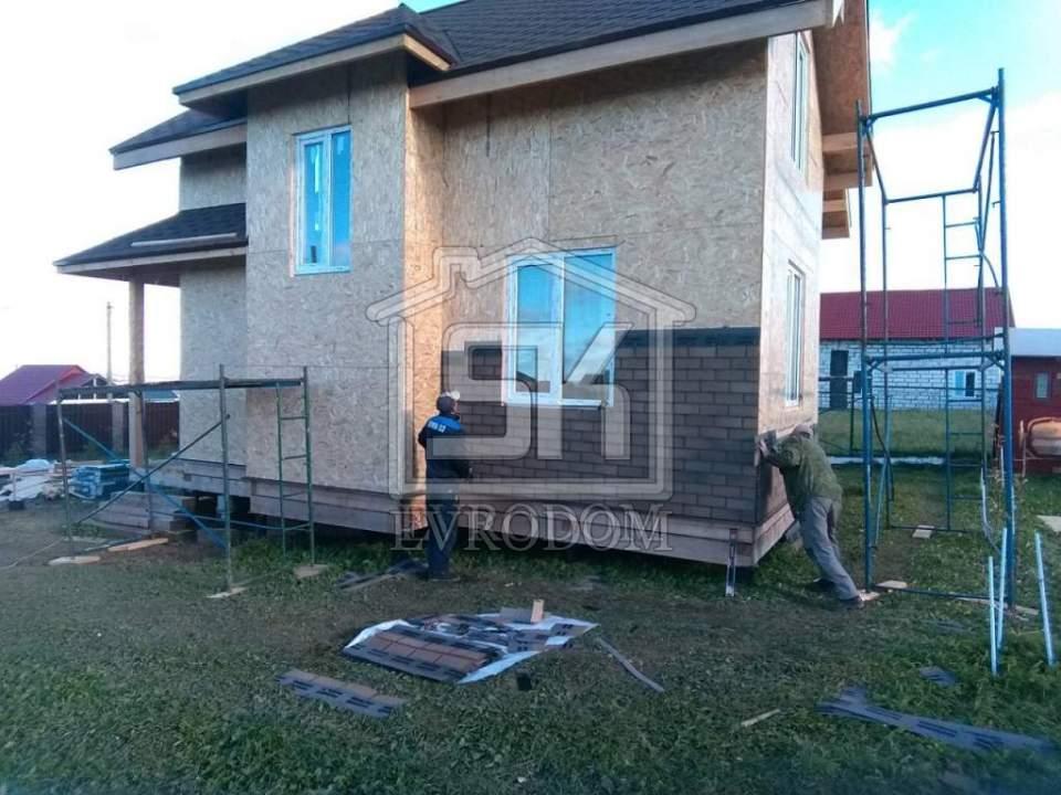 Отделка фасада дома из СИП панелей.